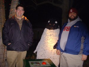 Josh and Jordan in front of a kind of creepy talking penguin
