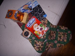 This is my stocking. it has candy canes and mints. I made the buttons myself!